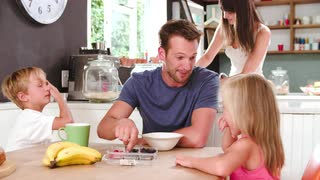 family-eating-breakfast-in-kitchen-together_4yi9bg-9__S0000