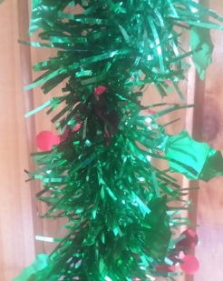 green tinsel with red balls