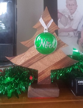 wooden christmas tree with noel ornament